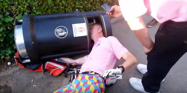 drunk golfer head in bin
